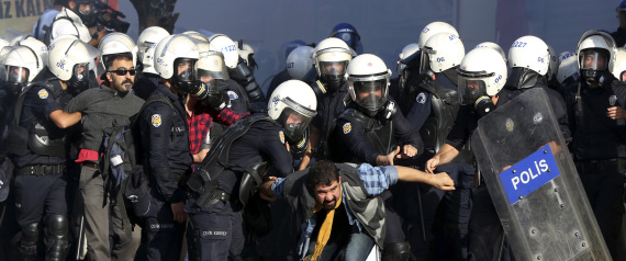 Kurdish Protesters seeking help from Turkey against ISIS clash with Turkish Police Oct. 7, 2014 . (AP Photo/Burhan Ozbilici)