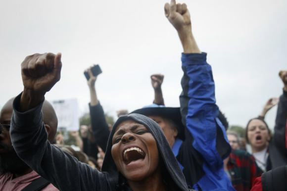 Protesters rally during a demonstration outside the Ferguson police department in Ferguson, Missouri