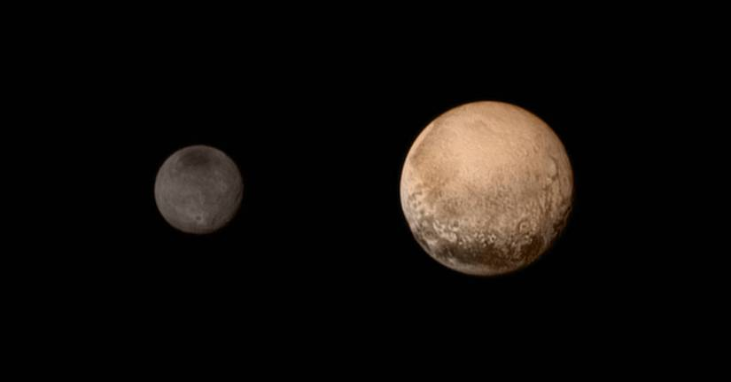 Pluto and it's moon Charon in color taken by New Horizon's.  All pictures from NASA's picture Galary.