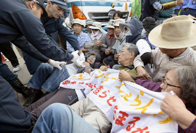 Residents protesting the Okinawa Relocation of the US Army Base Photo Credit: KYODO / Reuters