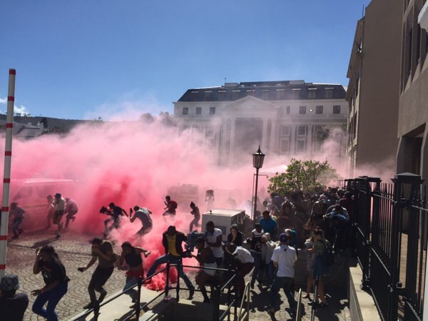 Tear gas fired on students protesting in South Africa against an enormous raise in tuition and fees. Photos by Lionel Adendorf See CNN http://www.cnn.com/2015/10/27/africa/fees-must-fall-student-protest-south-africa-explainer/index.html