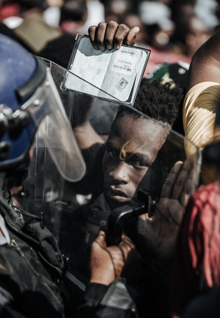 A student in the #FeesMustFall protest in South Africa protesting higher student tuition October 23, 2015. Photo by Andreas Georghiou